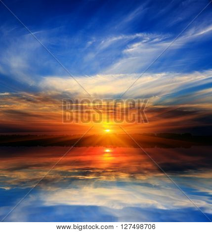 Magic sunset scene over water surface