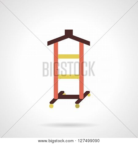 Rack with yellow rods and brown hanger element for hanging shirts and dresses. Wardrobe equipment. Atelier objects. Flat color style vector icon. Web design element for site, mobile and business.