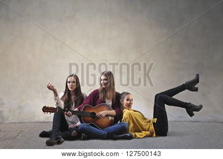 Group of friends singing and playing