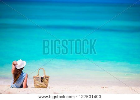 Young beautiful woman relaxing at white sand tropical beach