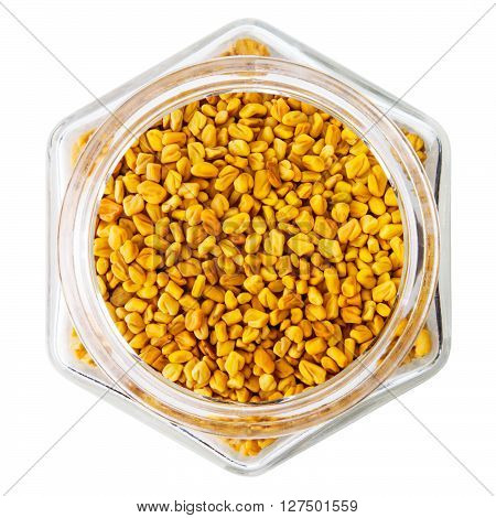 Fenugreek seeds in glass bottle, isolated on white  background