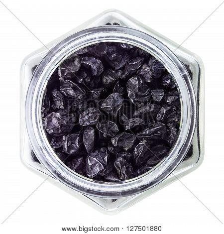 Dried barberry berries in glass bottle, on white background
