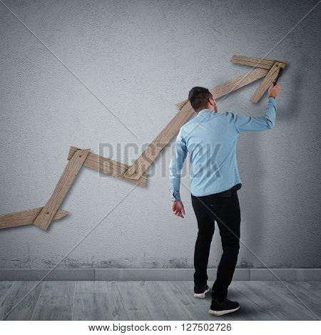 Man builds with a hammer an arrow