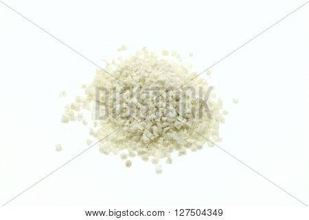 Close-up of pile of Grey Salt on white background.Isolated