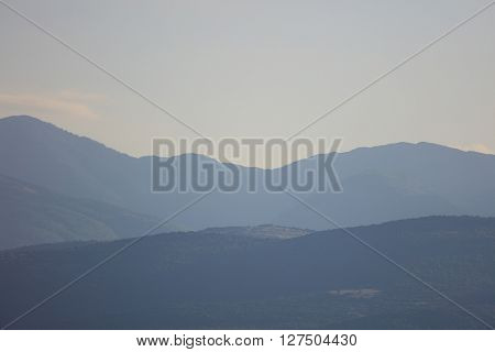 View on mountains silhouette in daylight