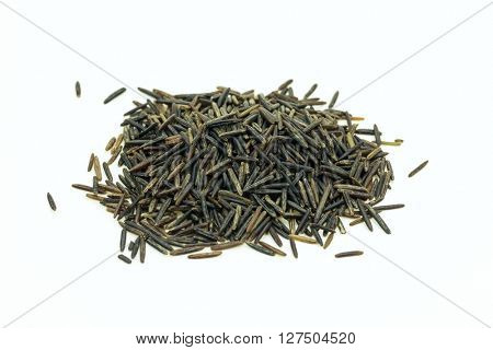 Heap of wild rice in close-up of white background.Isolated
