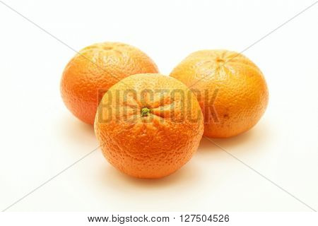 Close-up of three tangerines on white background.Isolated.