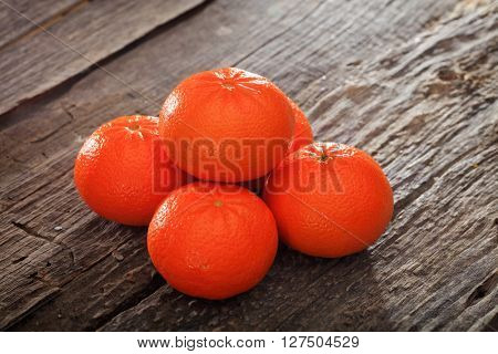 Close-up of juicy tangerines on wooden table