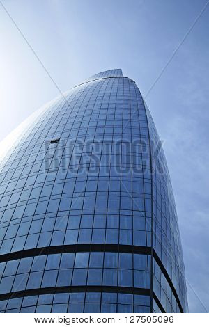 Panoramic and perspective wide angle view to steel blue background of glass high rise building skyscrapers in modern futuristic city. Business concept of successful industrial architecture