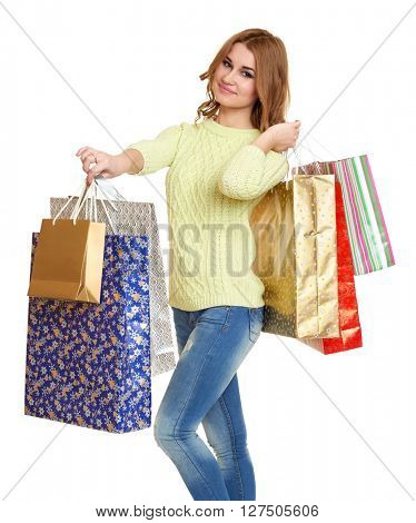 girl with shopping bag casual dressed jeans and a green sweater posing in studio on white background