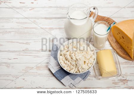 Milk and dairy products on a wooden table