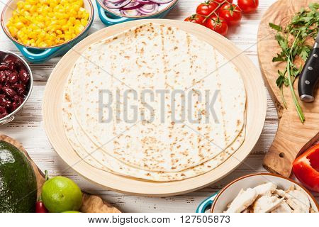 Traditional mexican tortilla with a mix of ingredients