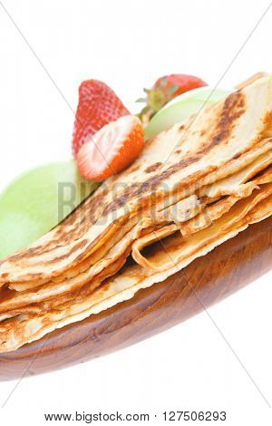 baked food : pancake with honey strawberries and apple isolated on white background . shallow dof