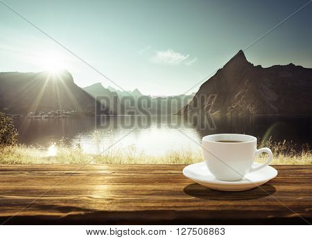 cup of coffee and sunset in Norway, Lofoten islands