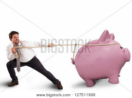 Man pulls the rope with a piggybank