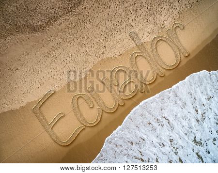 Ecuador written on the beach