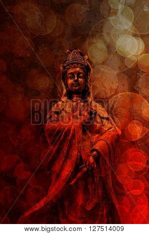 Kuan Yin Goddess of Compassion Bronze Statue Standing on red grunge texture blurred defocused bokeh background