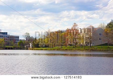 Northern Virginia neighborhood in early spring. City panorama of residential buildings near the water.