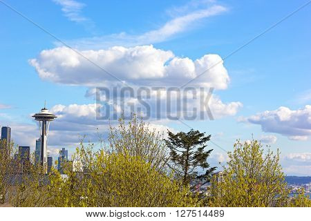 SEATTLE, WASHINGTON, USA - MARCH 25: Kerry Park neighborhood in spring with a view on the Space Needle in Seattle on March 25, 2016. Seattle Space Needle under the clouds on a spring afternoon.