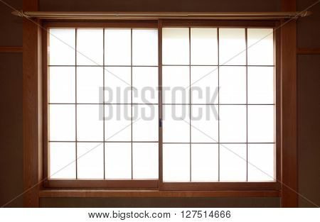 Traditional Japanese rice paper window with sliding wooden frame