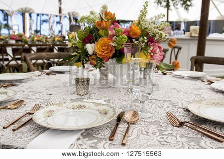 Vintage place settings at wedding reception