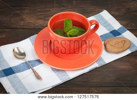 Orange Teacup And Saucer