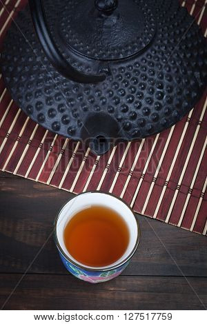 Traditional Japanese Cast Iron Teapot With Teacup.