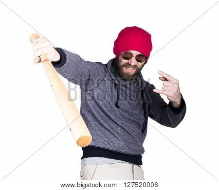 Fashion hipster cool man in sunglasses and colorful clothes brandishing a baseball bat.