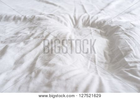 abstract background of white crumpled dense fabric