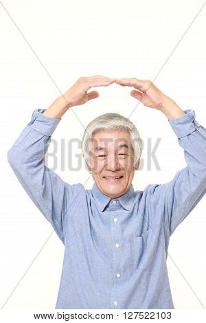 portrait of senior Japanese man making OK gesture on white background