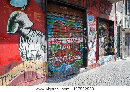 Naples Italy - August 9 2015: Naples street view with graffiti over grungy wall