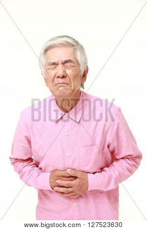 studio shot of senior Japanese man suffers from stomachache on white background
