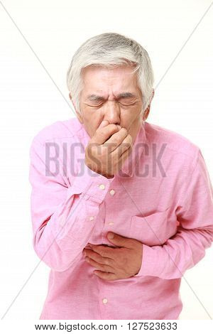 studio shot of senior Japanese man feels like vomiting on white background