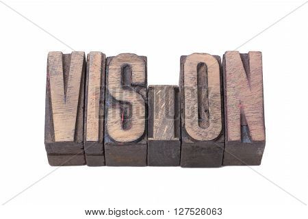 vision word made from tilted wooden letterpress type isolated on white