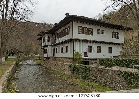 Old traditional houses and river with bridge in Ether, Gabrovo, Bulgaria