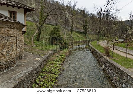 Old traditional houses and river in Ether, Gabrovo, Bulgaria