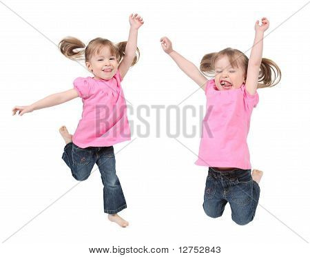 Adorable Little Girls Jumping In Air. Isolated On White Background