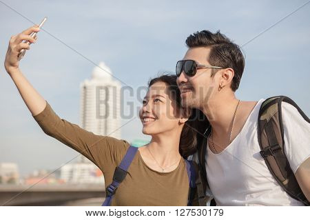 portrait of young man and woman selfie self portrait by mobile phone in relaxing emotion sea beach destination use for people in modern life style