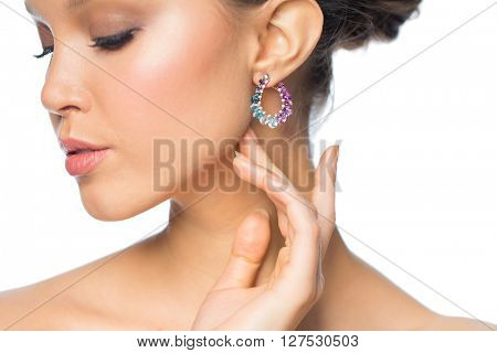glamour, beauty, jewelry and luxury concept - close up of beautiful woman face with earring