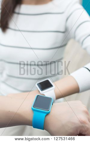 Group of friends using smart watch together