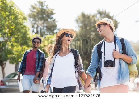 Happy young couple walking on road and having fun