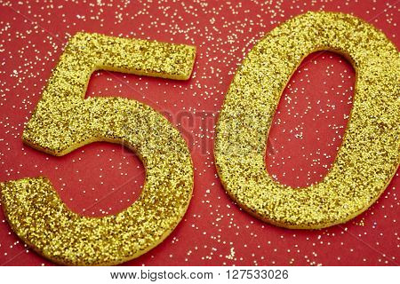 Number fifty golden color over a red background. Anniversary. Horizontal