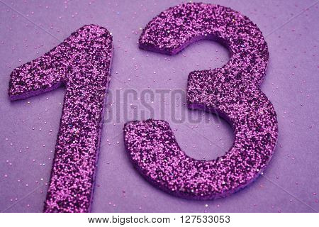 Number thirteen purple color over a purple background. Anniversary. Horizontal