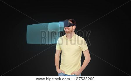 3d technology, virtual reality, entertainment and people concept - happy young man in virtual reality headset or 3d glasses with screen projections sover black background