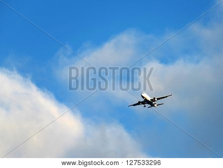Airplane flying against the blue sky