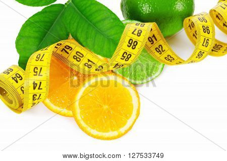 Halves Of An Orange And Lime With Measuring Tape On A White Background