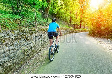 Cyclist Pedaling Uphill