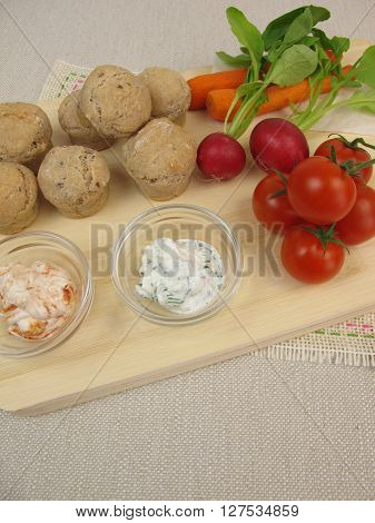 Small party rolls, cherry tomatoes, red radishes, carrots and dipping sauce