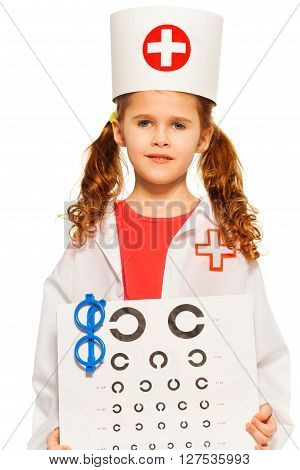 Portrait of young girl playing doctor ophthalmologist, isolated on white background