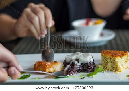 Thai dessert black sticky rice pudding and coconut custard square